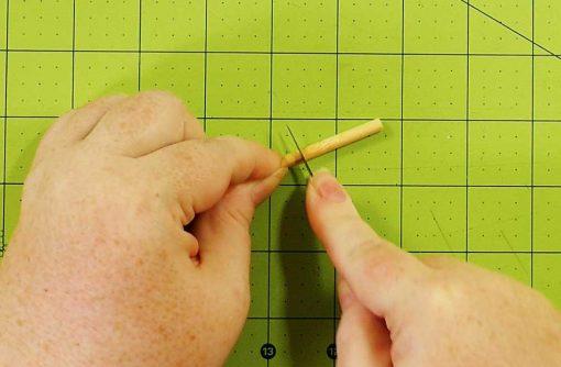 Cut off a piece of dowel or chopstick to make a peg