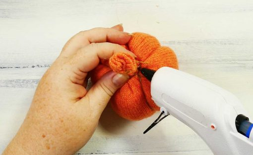 Glue the end of the thread on your sweater pumpkin