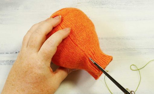 Notch the top edge of your sweater next to the seam