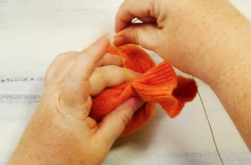 Wrap the thread around the top of your sweater pumpkin