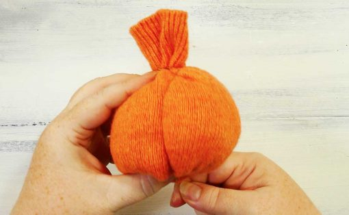 Wrap thread around the sweater pumpkin to create segments