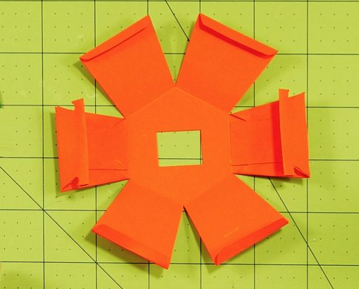 Fold and glue the bottom of the pumpkin paper bomb