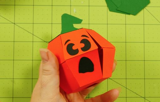 Glue on a face for your pumpkin paper bomb