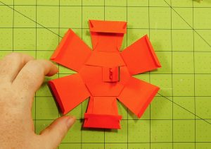 Glue the mechanism into the TOP piece of the pumpkin paper bomb
