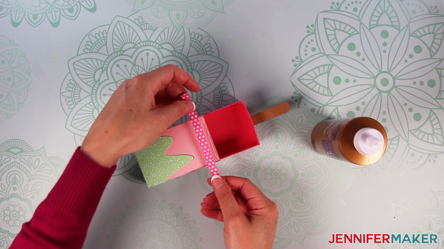 Attach ribbon to base of outer sleeve of popsicle box