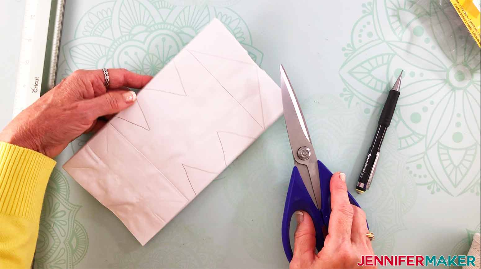 use heavy duty scissors to cut the design drawn on your bags for my 3D Snowflake
