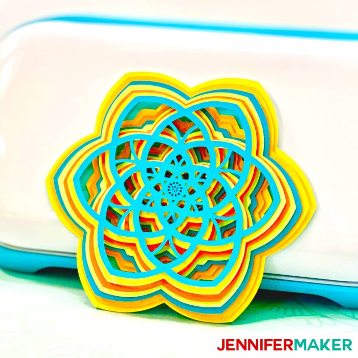 Easy 3d layered mandala shaped like a flower in front of a Cricut Joy