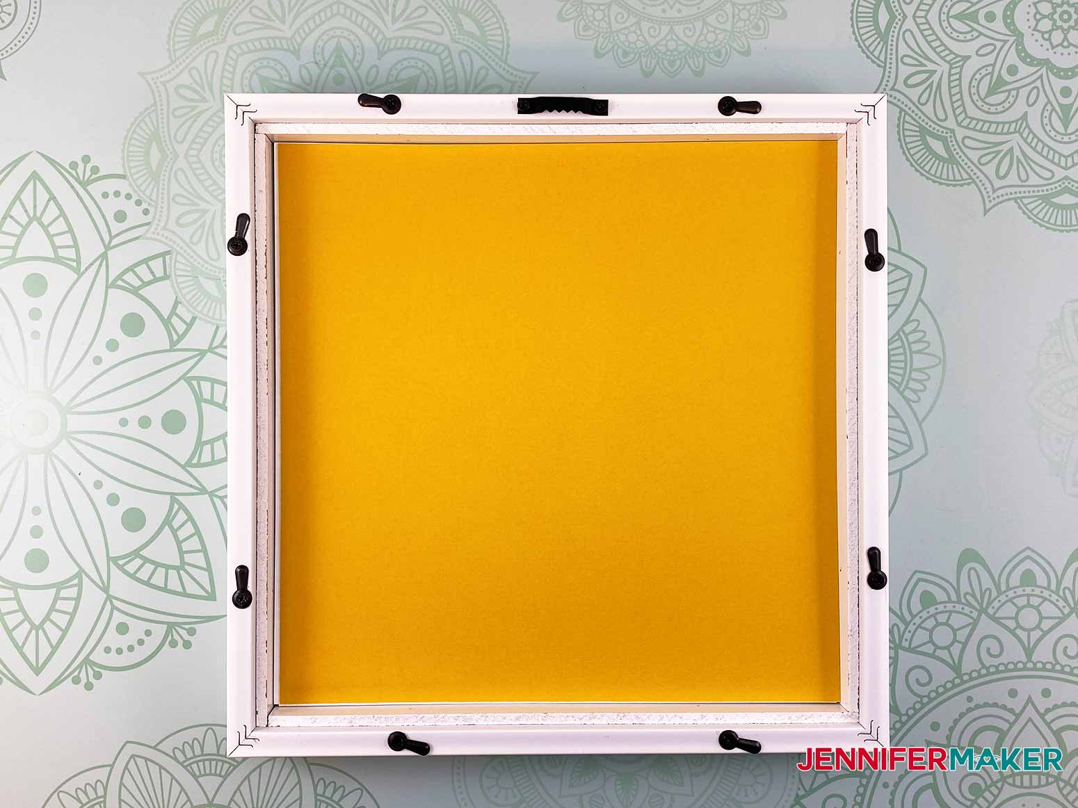 Add a contrasting layer of cardstock on top of the stacked layers in the picture frame for my 3d layered paper cut art project