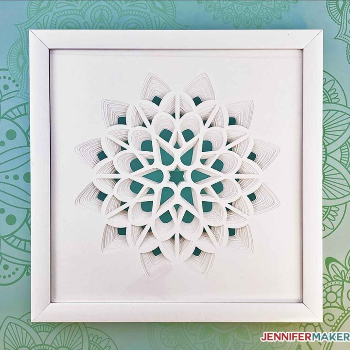 Make a 3D Layered Paper Cut Flower made from white cardstock in a white frame with our free SVG cut file