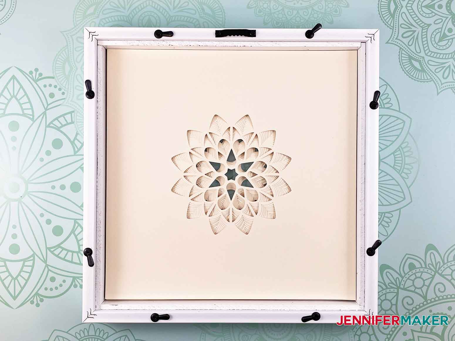 Insert your cut layers of cardstock into the frame for the 3D layered paper cut art flower