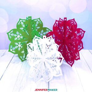 Pretty 3D paper cut ornaments in green, red, and white