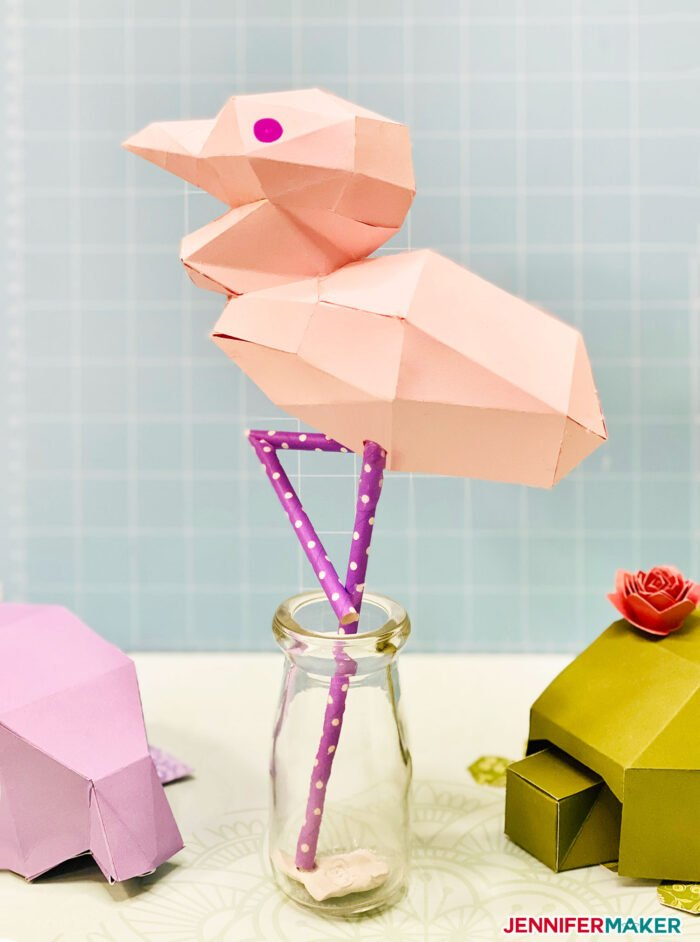 3D paper flamingo papercraft made from pink cardstock and purple polka dot straws