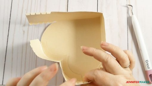 Gluing the bottom of the 3D Paper Heart Box