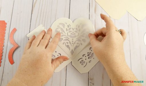 Glue vellum to wrong side of box lid for your 3d paper heart box