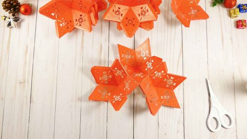 Attach a third star to your 3d paper star