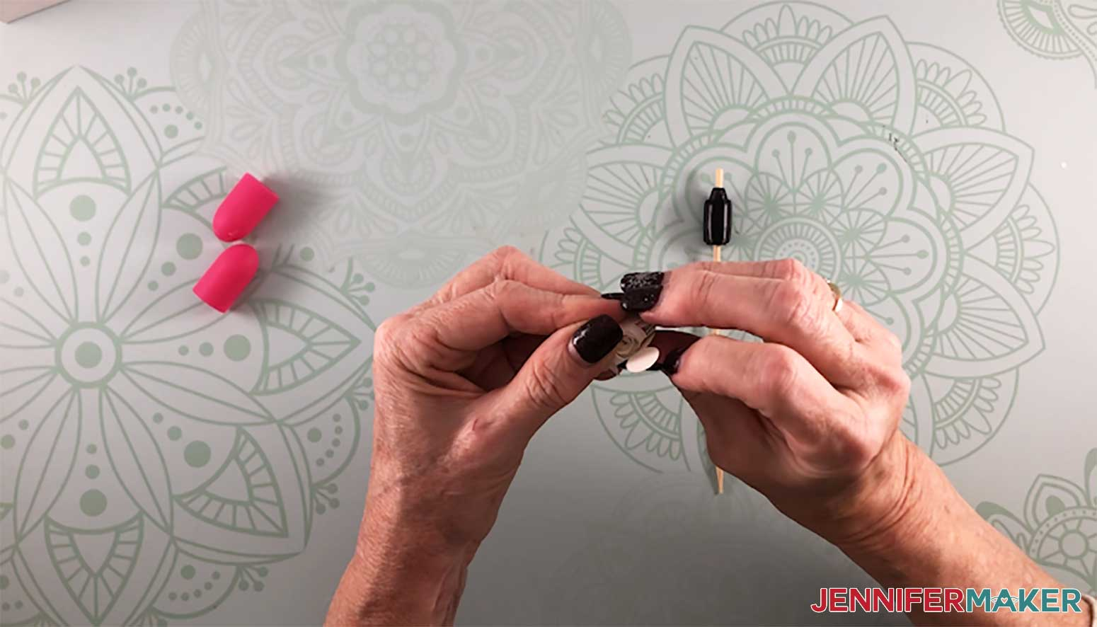 Gluing a paper rose with a DIY quilling tool to make a paper flower shadow box