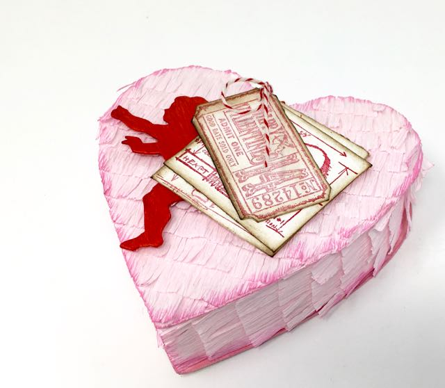 A pretty pink paper heart box made by PaperGlitterGlue.com