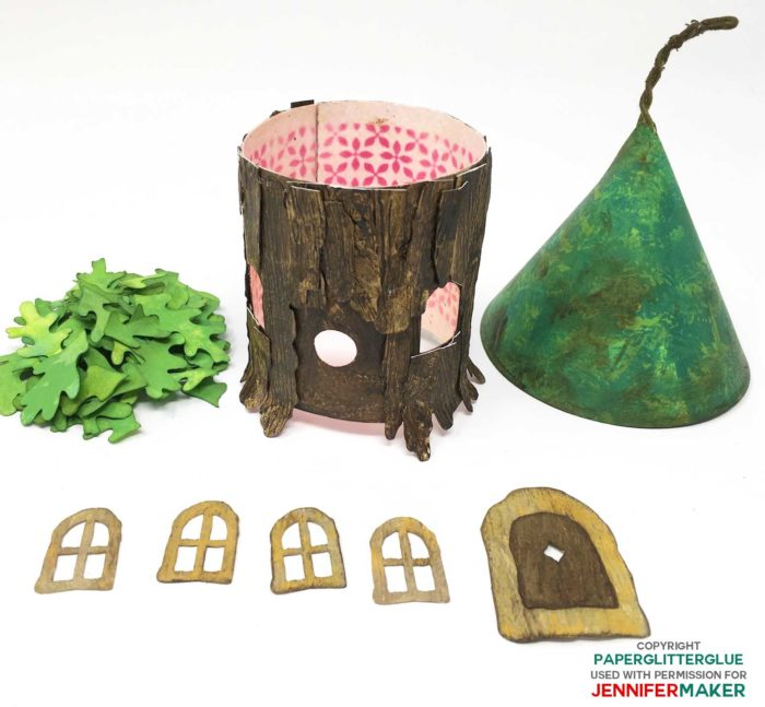 Colored and distressed paper pieces needed to make the DIY fairy house with a oak leaf roof