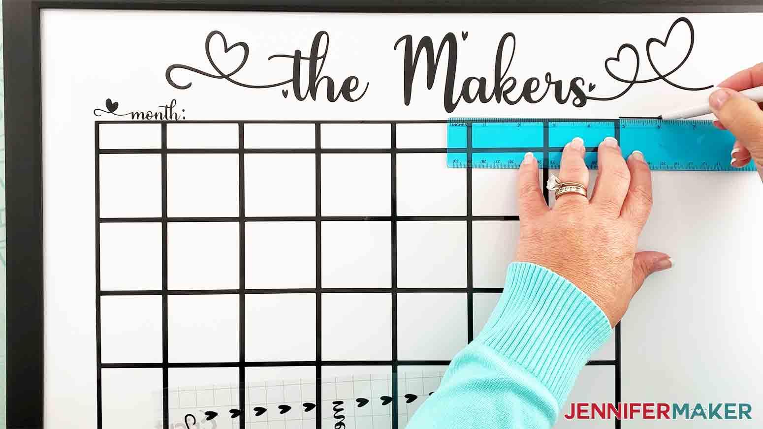 DIY-Whiteboard-Calendar-JenniferMaker-mark-line-for-notes-and-menu-vinyl-placement