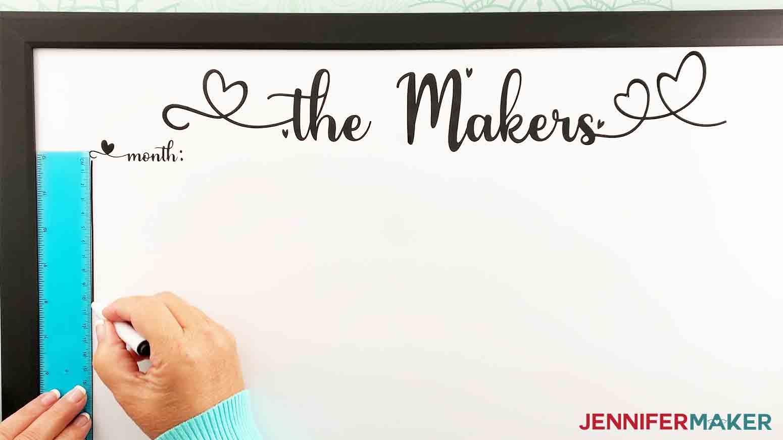 DIY-Whiteboard-Calendar-JenniferMaker-measure-and-mark-spot-for-vinyl-calendar-placement