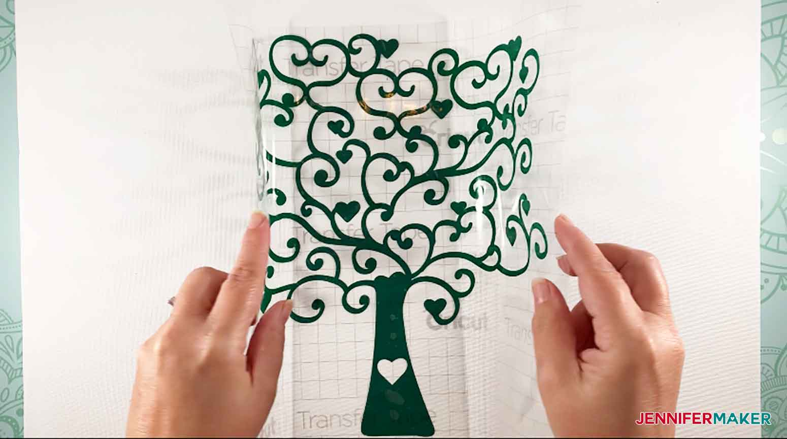 Applying Vinyl Heart Tree to canvas for Easy Paper Heart Tree by JenniferMaker
