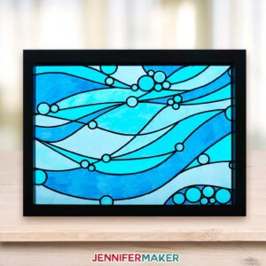 Faux stained glass window in shades of blue in a bright room