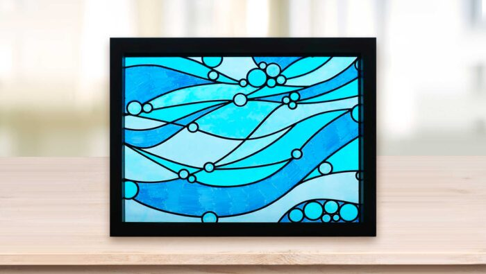 Faux stained glass window with blue waves made with Sharpie markers and vinyl lead lines on a Cricut