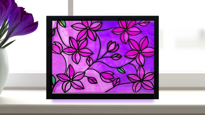 Faux stained glass window with flowers made with Sharpie markers and vinyl lead lines on a Cricut