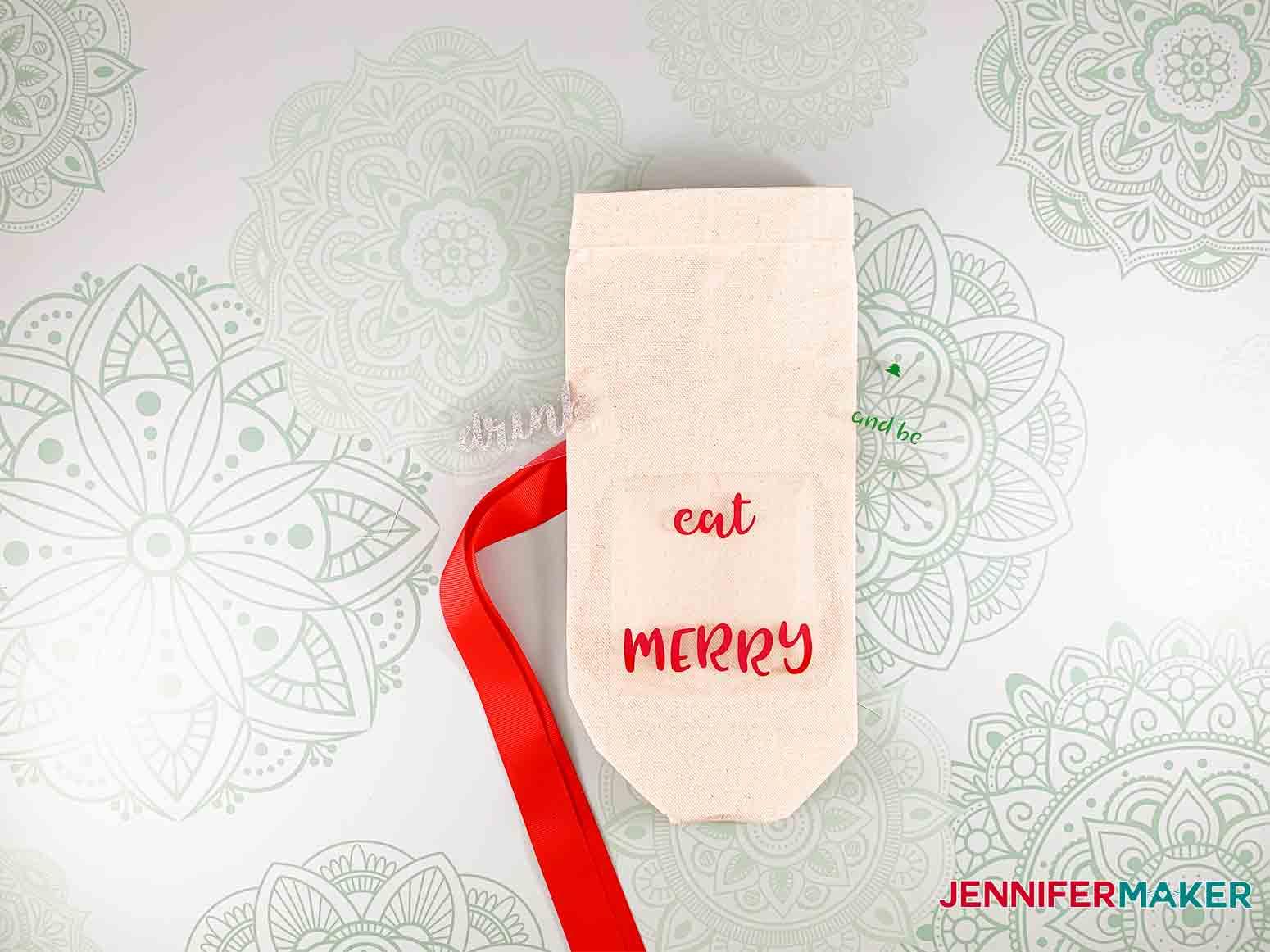 Festive-Holiday-Wine-Totes-JenniferMaker-add-svg-Iron-on-vinyl