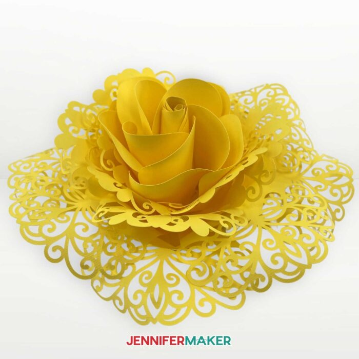 Side view of a yellow cardstock lace paper flower made on a Cricut!