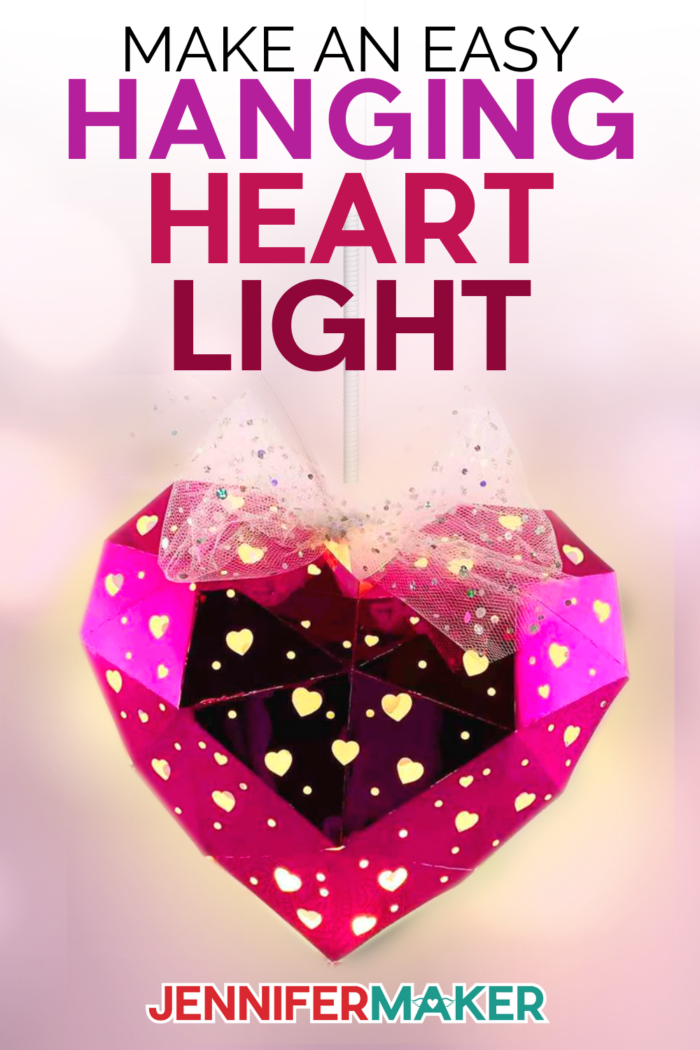 Make a heart shaped hanging paper lantern! Free SVG cut file and full instructions to make this on your Cricut at home!