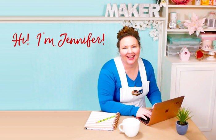 Jennifer Maker at her laptop in her craft room