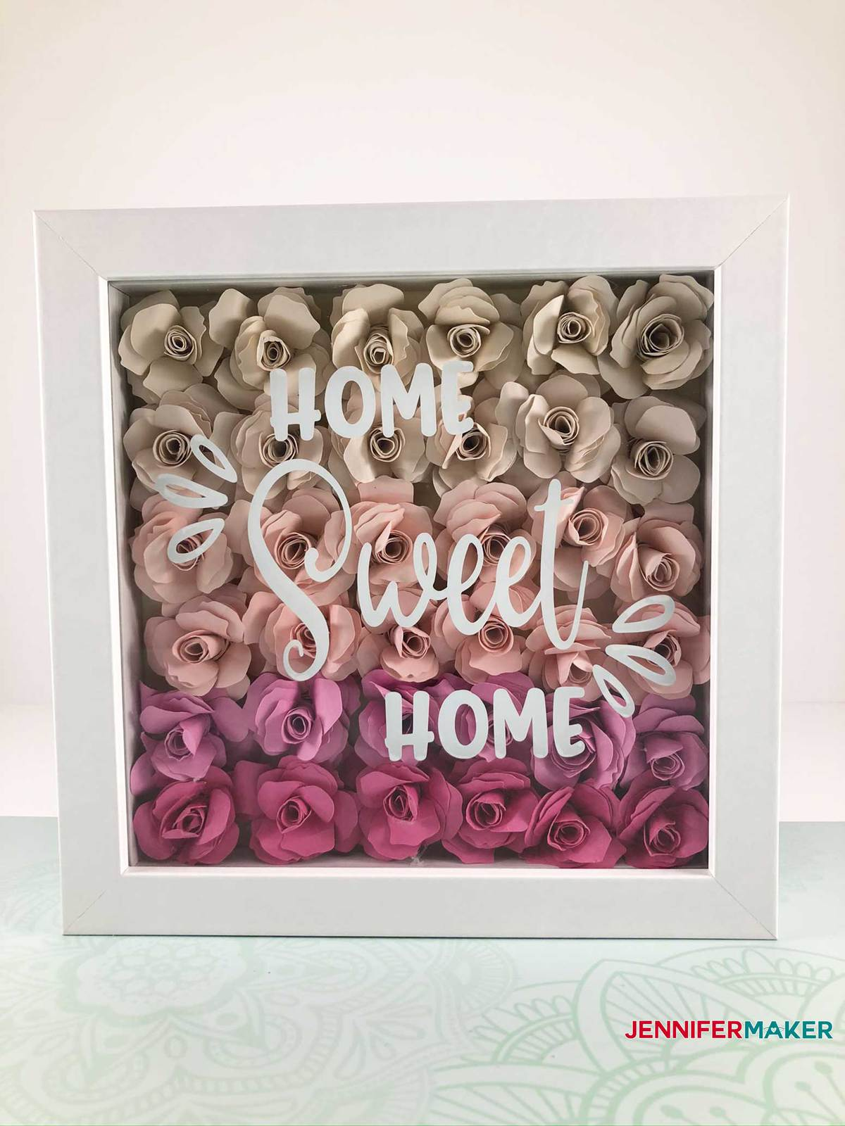 "Paper Flower Shadow Box with pink flowers and ""Home Sweet Home"" in white vinyl"