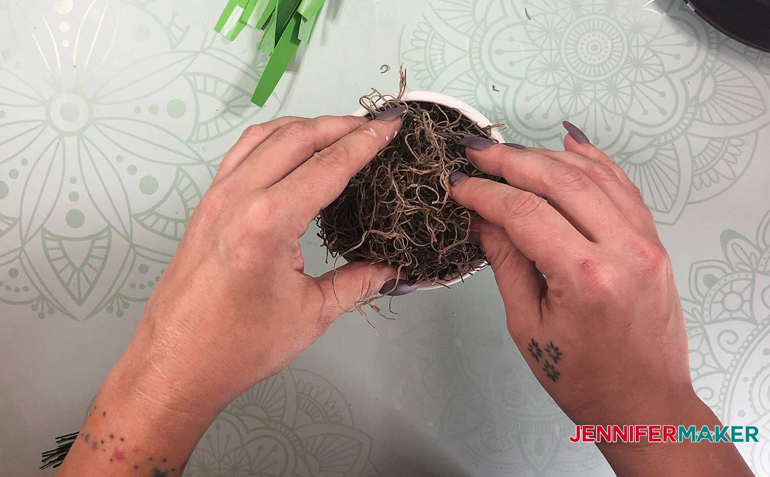 Completely cover the floral ball in spanish moss for your paper spider plant