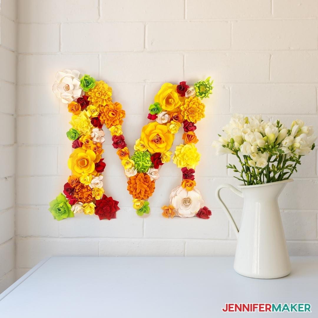 pretty paper flower letter next to flower bouquet