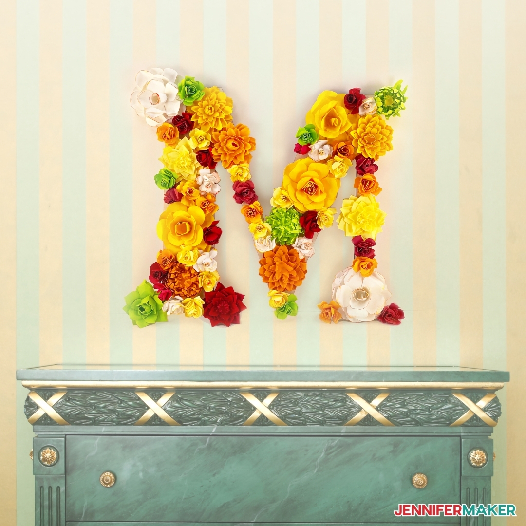 pretty paper flower letter on the wall over a side table