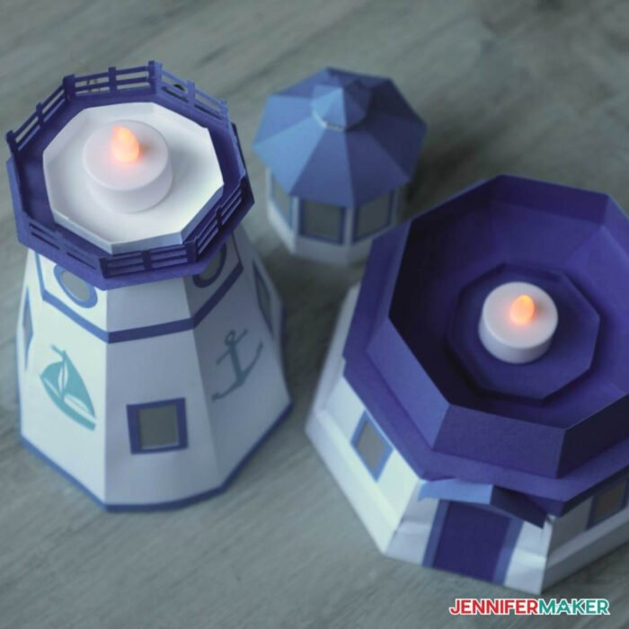 LED tealights inside the paper lighthouse luminary made with blue and white cardstock