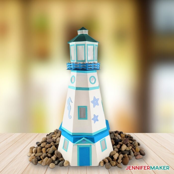 Paper Lighthouse Luminary made from blue and white cardstock and vellum, cut on a Cricut with a free SVG cut file and printable PDF pattern