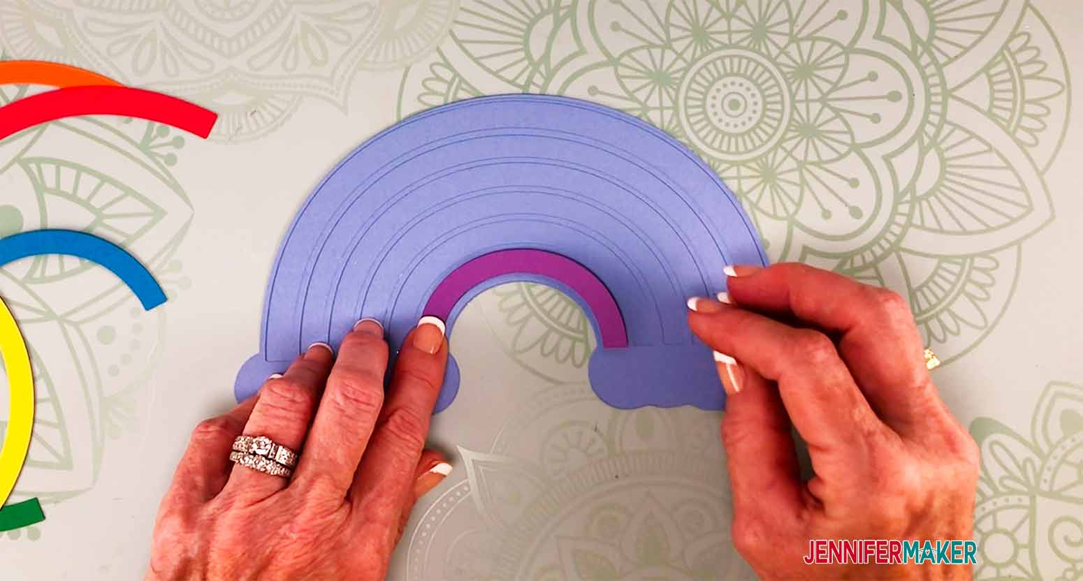 placing rainbow in place on my personalized cake topper