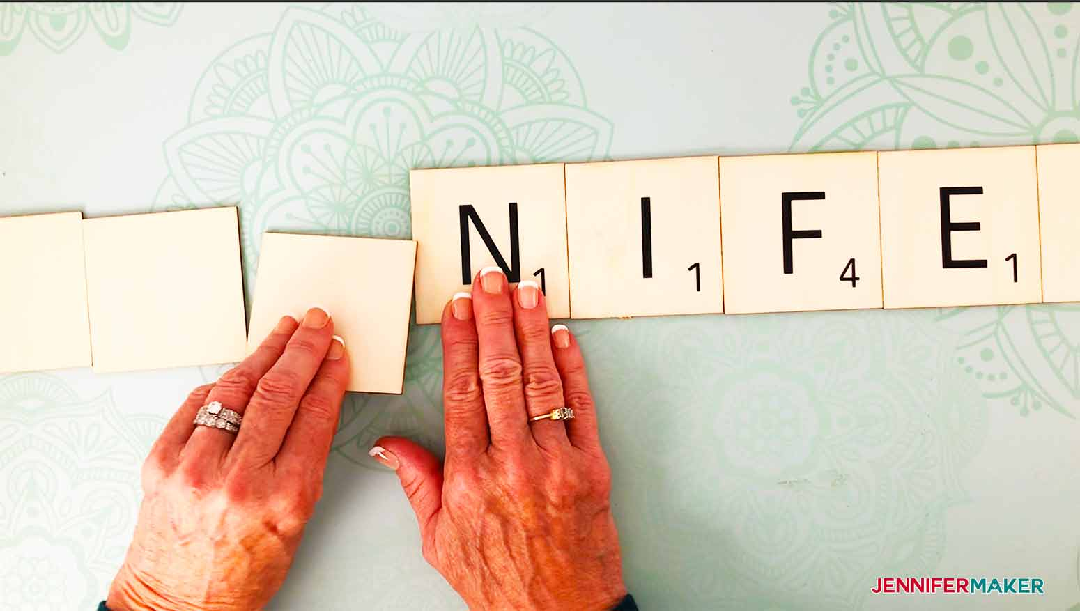 flip the letters over by grabbing them from the top and turning them towards you for my scrabble wall art