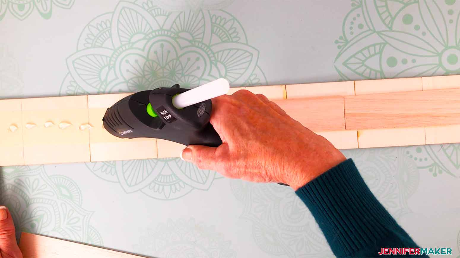 glue along the masking tape to place wood pieces assuring you straddle the tiles for my scrabble wall art