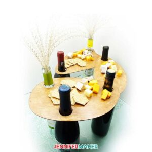 Wood wine bottle serving tray with wine bottles and cheese
