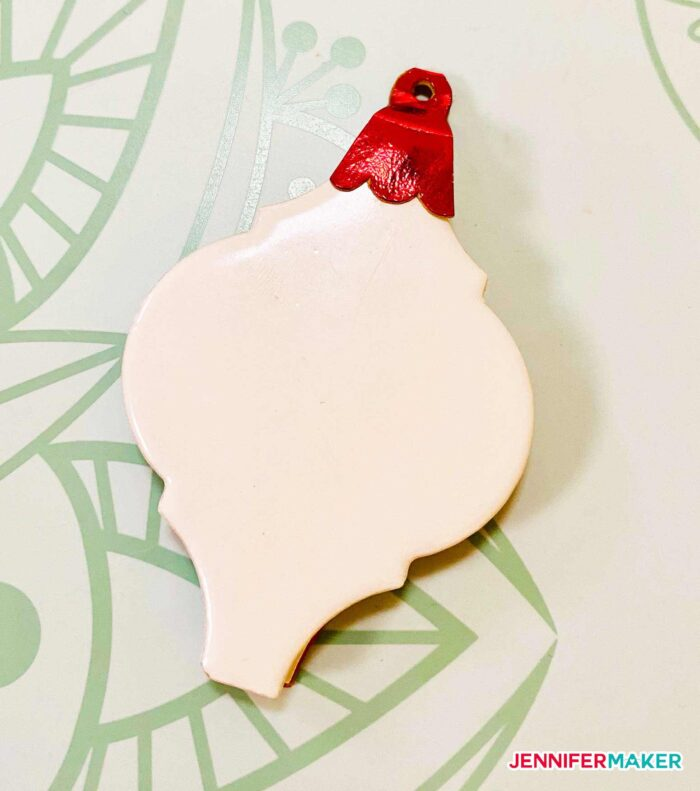 Arabesque tile ornaments with a foil Kraft board cap hanger in red