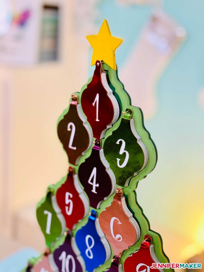 Side view of the tile ornament tree with ceramic tiles on it.
