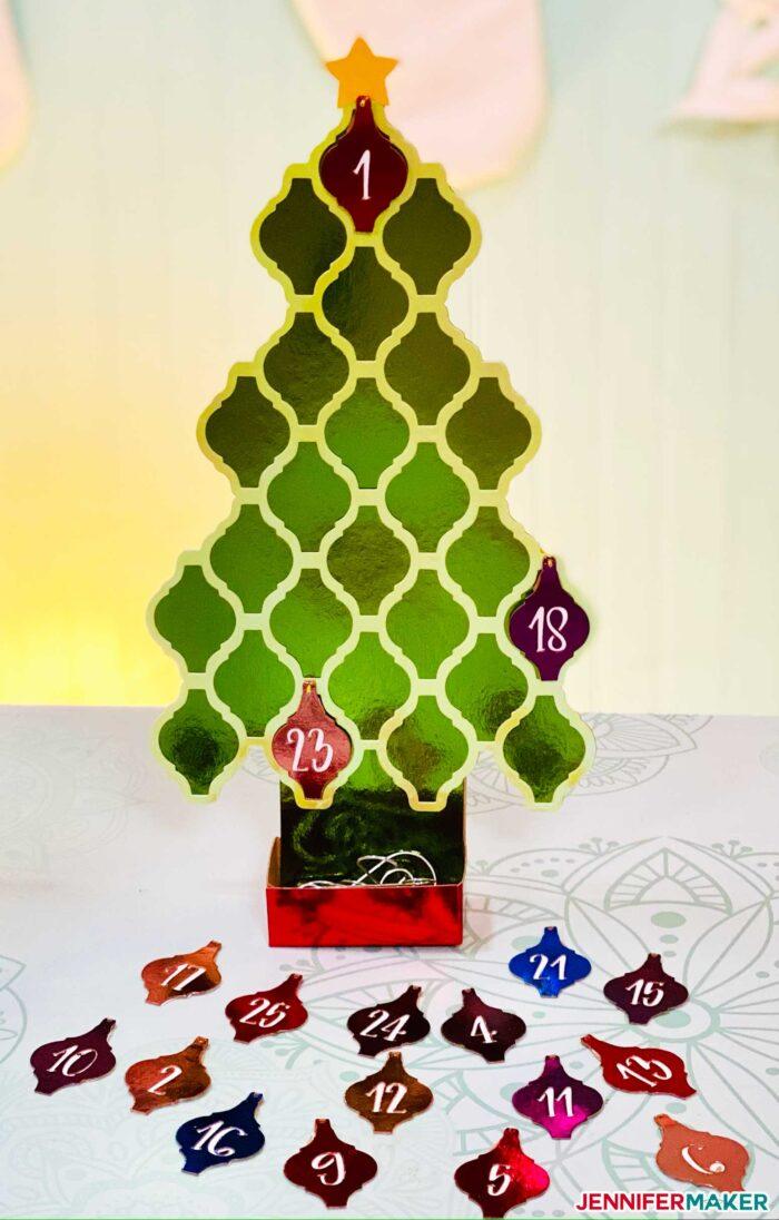 Foil Kraft board cut into an arabesque tile ornament tree countdown calendar on the Cricut explore Air