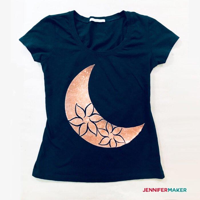 A pretty black bleach stencil shirt with a moon flower design