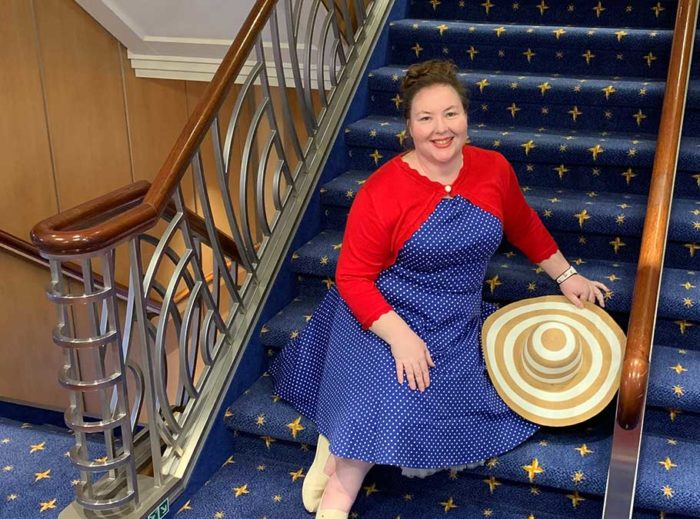 Blue polka dot vintage-style dress on the Disney Dream