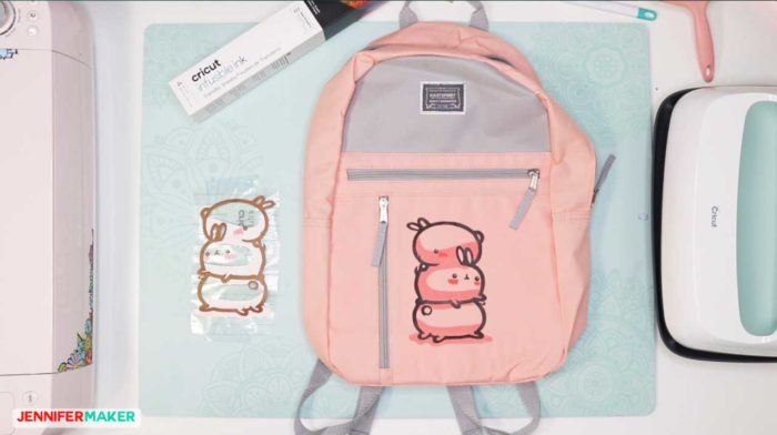 Pink backpack with a Cricut Infusible Ink transfer on it of three bunnies