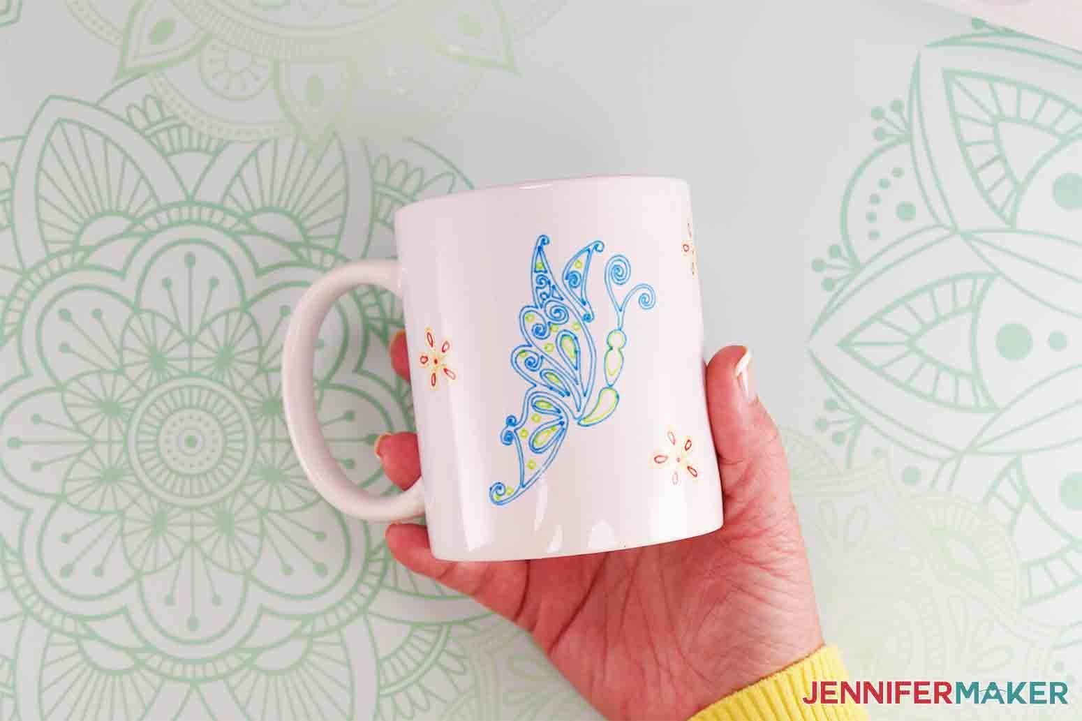 showing finished infusible ink pen cricut mug