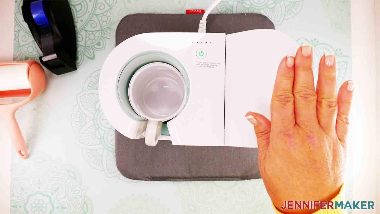 pressing down lever to start Cricut Mug press
